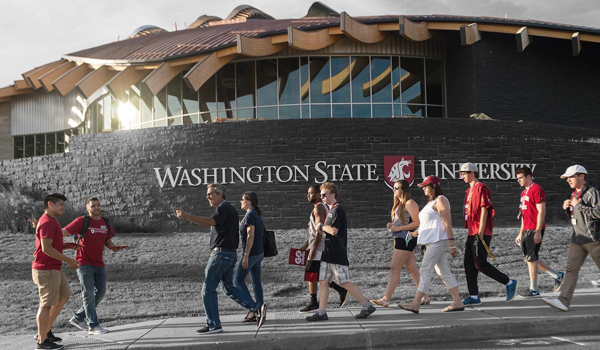 Alive! participants walk past the Elson S. Floyd Cultural Center during a campus tour